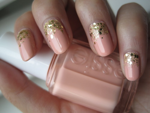 Any gold glitter nail polish A Crewed Interest by Essie I love how the glitter looks on this nail, tres fabu, non?